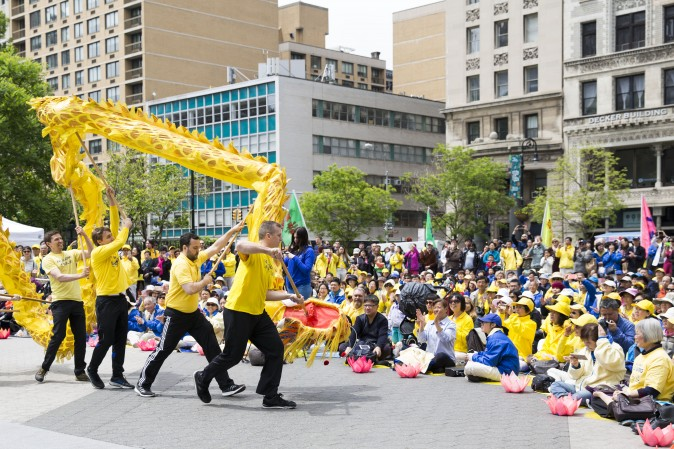 Falun Dafa practitioners participate in a World Falun Dafa Day activity at Union Square, New York City, on May 11, 2017. (Samira Bouaou/The Epoch Times)