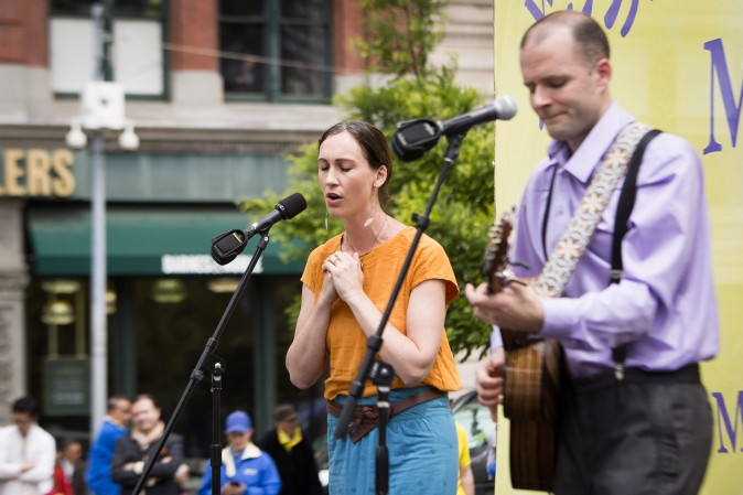 Katy Mantyk and Nemanja Rebic sing a song about the persecution of Falun Dafa practitioners inside China during the World Falun Dafa Day event held at Union Square, New York City, on May 11, 2017. (Samira Bouaou/The Epoch Times)