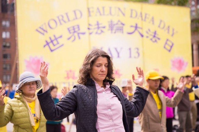 People perform the Falun Dafa exercises during the World Falun Dafa Day event at Union Square, New York City, on May 11, 2017. (Larry Dye/The Epoch Times)