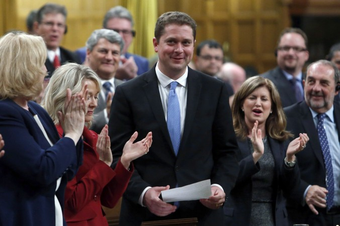 Conservative Leader Andrew Scheer receives a standing ovation during question period in the House of Commons on May 29, 2017. (The Canadian Press/Fred Chartrand)