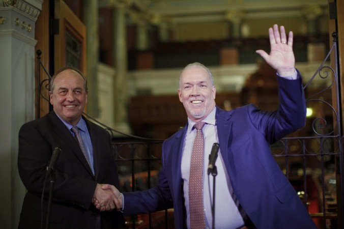 B.C. Green party leader Andrew Weaver and B.C. NDP leader John Horgan speak to media at the legislature in Victoria on May 29, 2017, after announcing they'll be working together to help form a minority government. The alliance casts doubt on the future of the Kinder Morgan pipeline expansion. (The Canadian Press/Chad Hipolito)