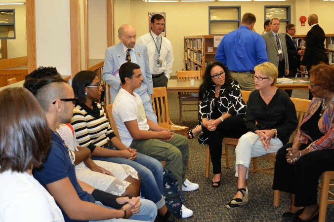 (L-R) Chancellor of the Board of Regents Betty Rosa, Assemblywoman Aileen Gunther, and Regent Judith Johnson speaks with Middletown high school students (left) in Middletown on Sept. 6, 2016. (Yvonne Marcotte/Epoch Times)