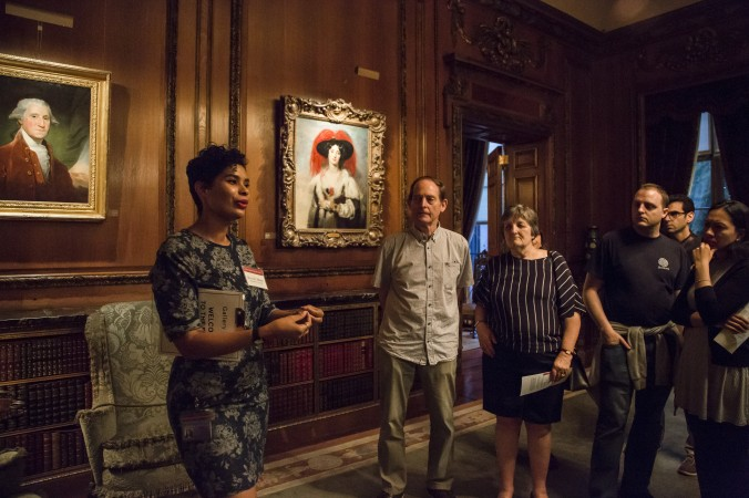 Rachel Himes, education assistant, introduces the museum at First Fridays event at The Frick Collection in New York City on June 2, 2017. (Samira Bouaou/The Epoch Times)