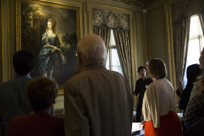 Vincent Tolentino (R), education assistant, gives a  talk at the First Fridays event at The Frick Collection in New York City on June 2, 2017. (Samira Bouaou/The Epoch Times)