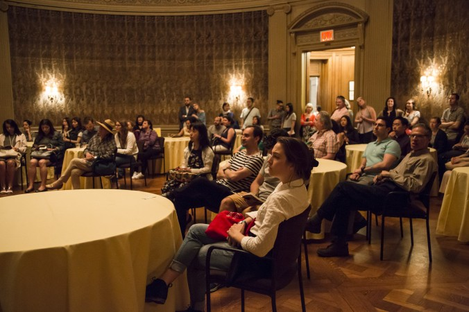 People listen to The Fat Afro Latin Jazz Cats performing during the First Fridays event at The Frick Collection in New York City on June 2, 2017. (Samira Bouaou/The Epoch Times)