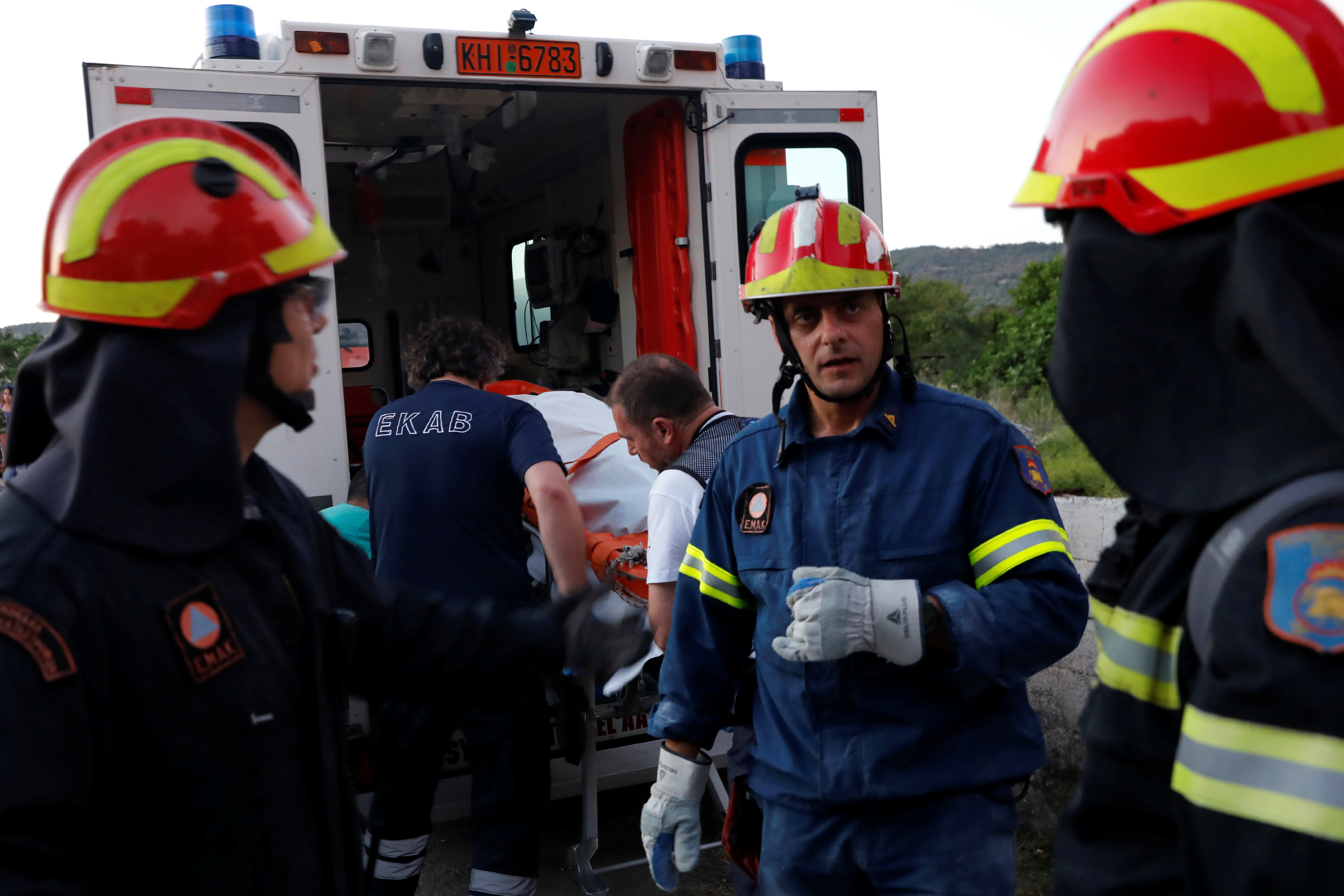 Rescue team members carry the body of a victim onto a ambulance, at the village of Vrissa on the Greek island of Lesbos, Greece, after a strong earthquake shook the eastern Aegean on June 12, 2017. (REUTERS/Giorgos Moutafis)