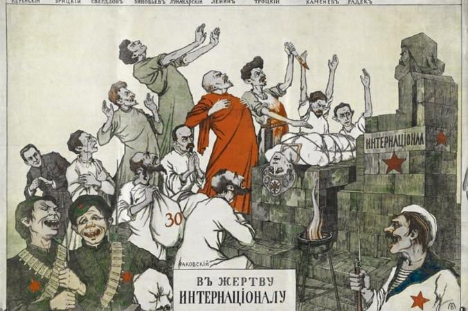 A White Russian anti-Bolshevik propaganda poster from 1919 depicts senior communist leaders Lenin, Trotsky, Kamenev, Radek, Sverdlov, and Zinoviev sacrificing an allegorical character representing Russia to a statue of Karl Marx. (Public Domain)
