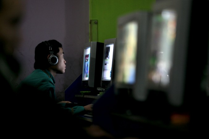 A Chinese youth plays online game in a net cafe on January 21, 2008 in Chongqing Municipality, China. (China Photos/Getty Images)