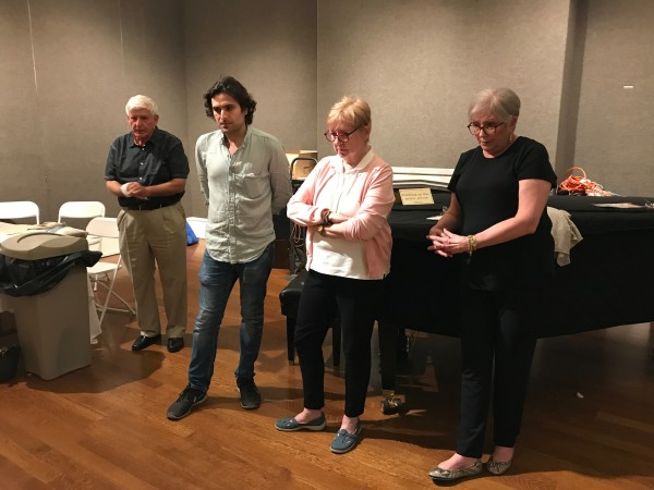 (L–R) Painting conservator, Alexander Katlan; artist and academic director of The Florence Academy of Art US, Jordan Sokol; acting president of the Salmagundi Club, Elizabeth Spencer; former president of the Salmagundi Club, Claudia Seymour decide on the winners of the Oil Portrait Sketching Competition at the Salmagundi Club in New York on Aug. 26, 2017. (Milene Fernandez/The Epoch Times)