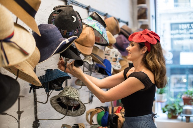 Jennifer Ouellette puts hats for display at her studio in New York on Sept. 15, 2017. (Benjamin Chasteen/The Epoch Times)
