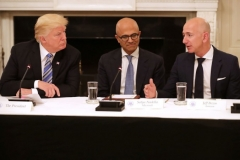 President Donald Trump, Microsoft CEO Stya Nadella and Amazon CEO Jeff Bezos attend a meeting of the American Technology Council in the State Dining Room of the White House in Washington, DC. on June 19, 2017. Trump criticized Amazon on Twitter on Aug. 16, claiming the company is hurting retailers and killing jobs. (Chip Somodevilla/Getty Images)