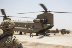 A U.S. soldier deployed in support of Combined Joint Task Force Operation Inherent Resolve waits while a CH-47 Chinook is refueled at Qayyarah West Airfield, Iraq, on May 29, 2017. (Army photo by Cpl. Rachel Diehm)