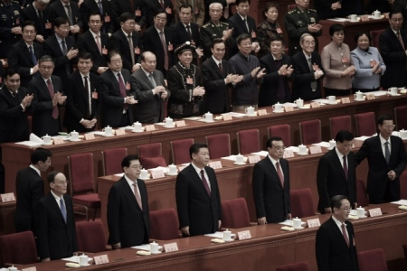 (L-R) Politburo Standing Committee member Wang Qishan, National People's Congress chairman Zhang Dejiang, Chinese leader Xi Jinping, Premier Li Keqiang, Politburo Standing Committee member Liu Yunshan and Politburo member Zhang Gaoli at the Great Hall of the People in Beijing on March 3, 2017. (Greg Baker/AFP/Getty Images)