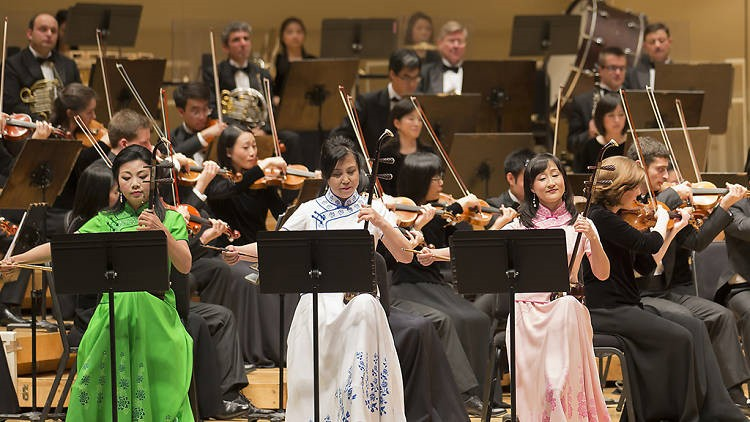 Western strings, percussion, woodwinds, and brass accentuate the sound of ancient Chinese instruments—like the two-stringed erhu, Shen Yun Symphony Orchestra.
